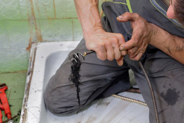 Snaking a shower drain to remove hair